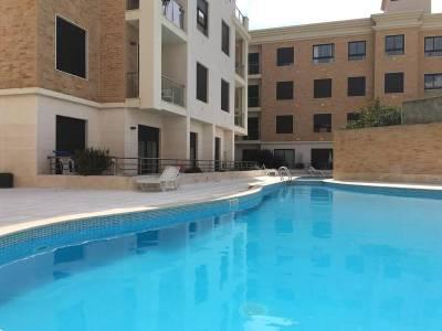 Meg N John's getaway place | 2 bedroom apartment w/ pool near the beach