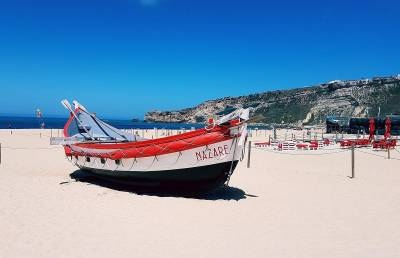 Traditional Nazare fishing boat on beach