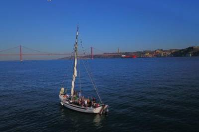 Sightseeing boat tour on a Tipical Wooden River Boat- See Lisbon like never seen