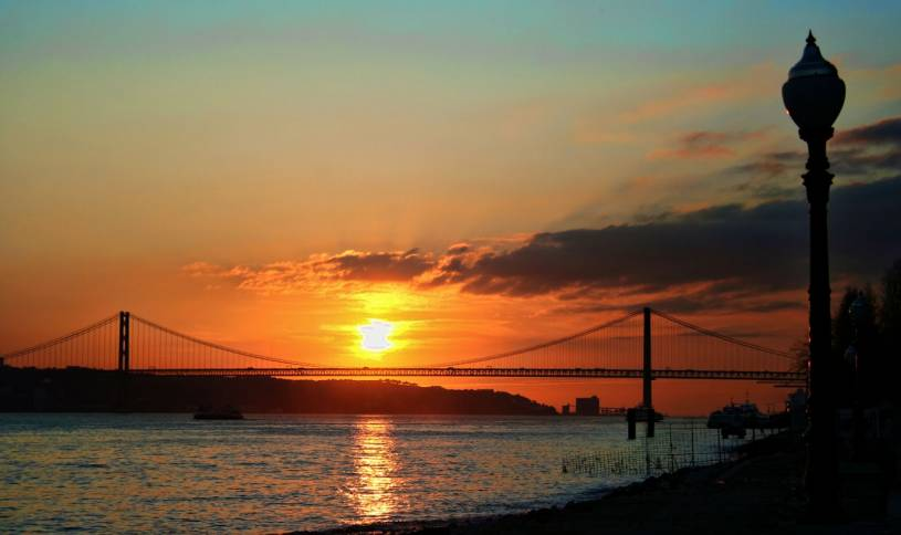Sunset over Lisbon 25 Abril bridge