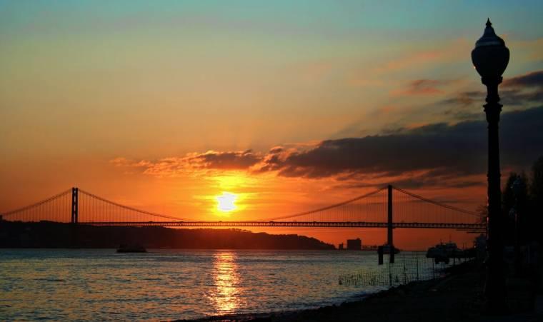 Sunset over Lisbon 25 Abril bridge