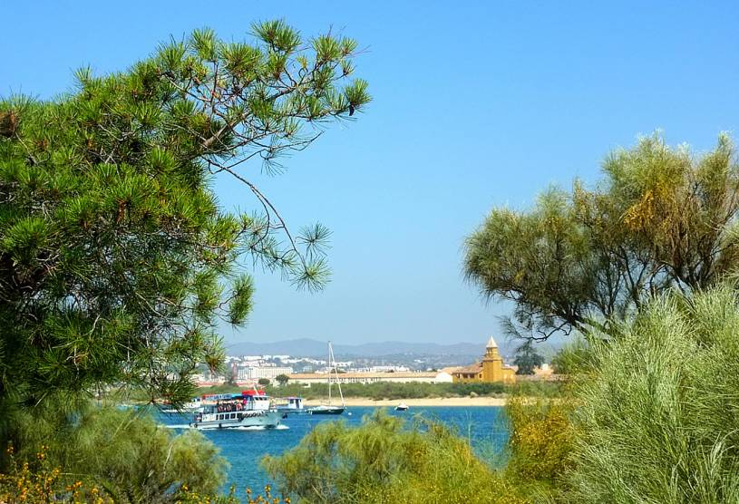View back from Ilha de Tavira to mainland and island ferry